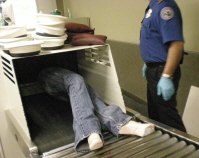 Man in airport xray scanner