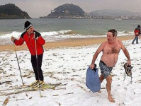 Snowy beach with skier