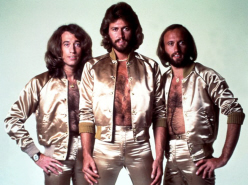 Bee-Gees silver leisure suits hiary chests