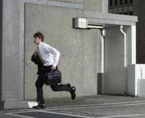 Executive running away