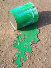 Empty green paint can