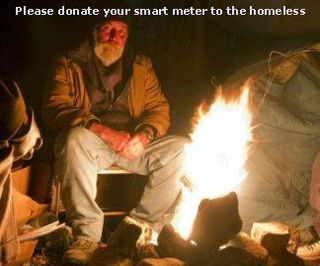 Homeless man by barrel fire staying warm