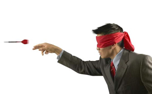 Blindfolded_man_throwing_darts