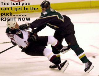 Big hard ice hockey check