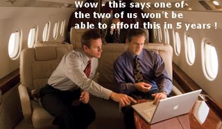 Men-laptop-at-table on private jet