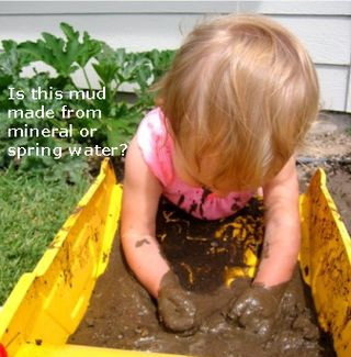 Kid baby playing in mud